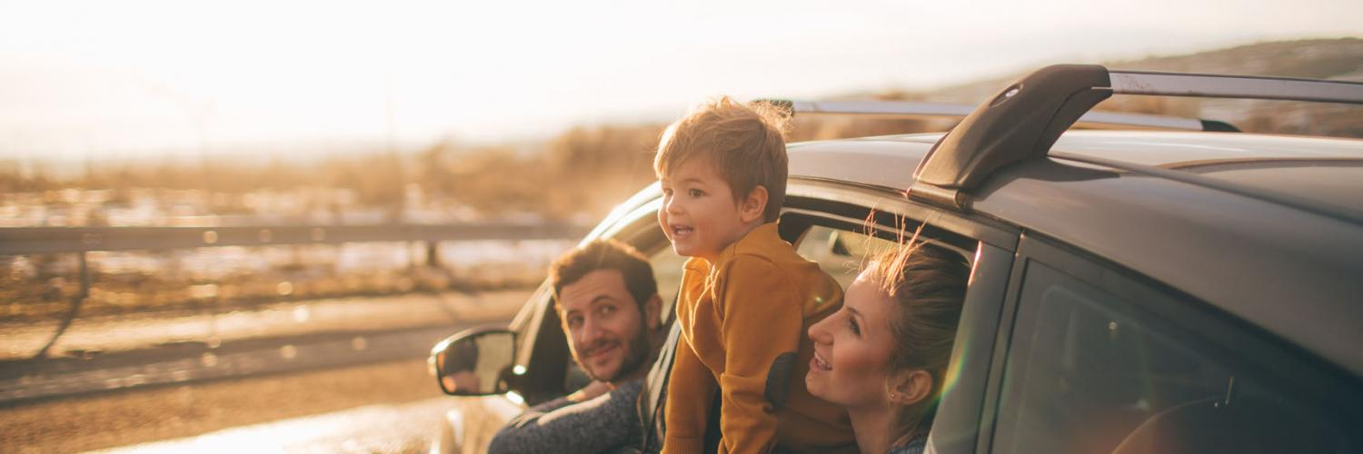 An image of a family in their car